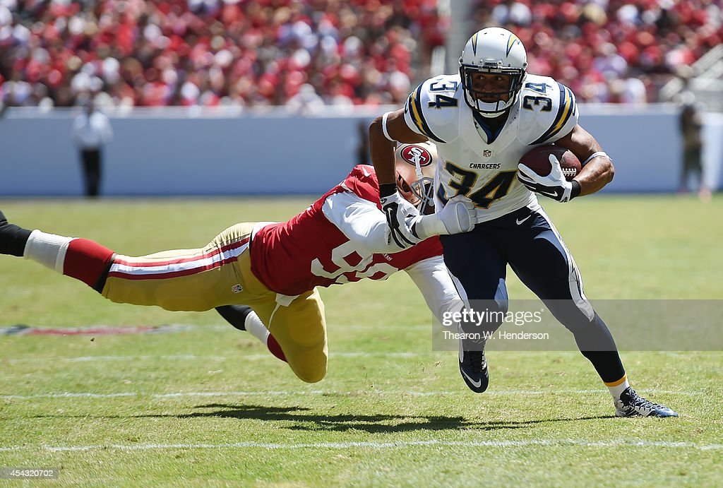 Donald Brown #34 of the San Diego Chargers breaks the tackle of <a gi-track='captionPersonalityLinkClicked' href=/galleries/search?phrase=Aldon+Smith&family=editorial&specificpeople=6522981 ng-click='$event.stopPropagation()'>Aldon Smith</a> #99 of the San Francisco 49ers on August 24, 2014 in Santa Clara, California.