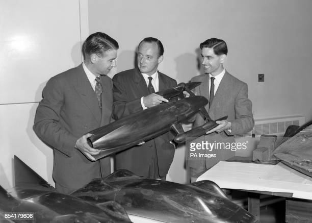 Donald Campbell and chief designers Lewis Norris and Kenneth Norris examine a model of the modified Bluebird to be used by Mr Campbell next month in...