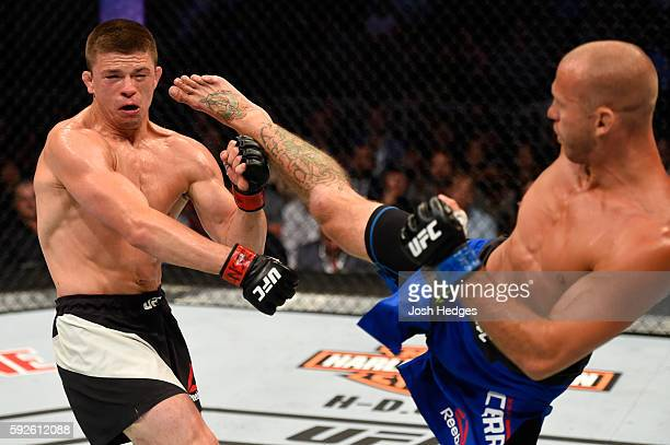 Donald Cerrone fights Rick Story in their welterweight bout during the UFC 202 event at TMobile Arena on August 20 2016 in Las Vegas Nevada