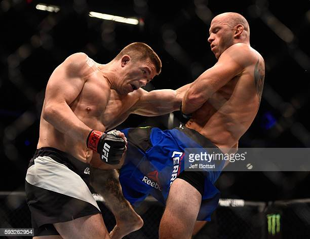 Donald Cerrone lands a knee to the body of Rick Story in their welterweight bout during the UFC 202 event at TMobile Arena on August 20 2016 in Las...