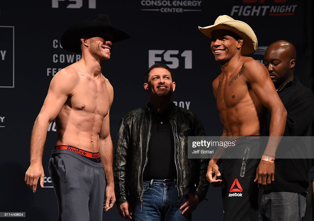 Donald Cerrone of the United States faces off against Alex Oliveira of Brazil during the UFC Fight Night weigh-in at Stage AE on February 20, 2016 in Pittsburgh, Pennsylvania.