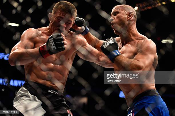 Donald Cerrone punches Rick Story in their welterweight bout during the UFC 202 event at TMobile Arena on August 20 2016 in Las Vegas Nevada