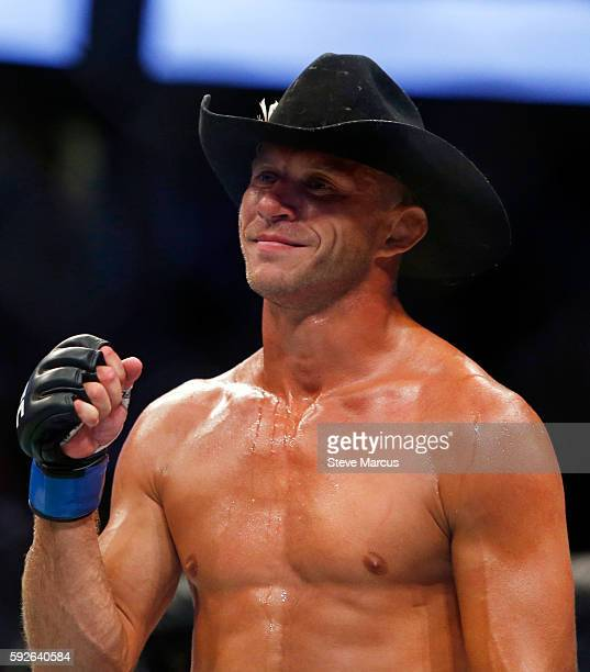 Donald Cerrone reacts after his secondround TKO win over Rick Story in their welterweight bout at the UFC 202 event at TMobile Arena on August 20...