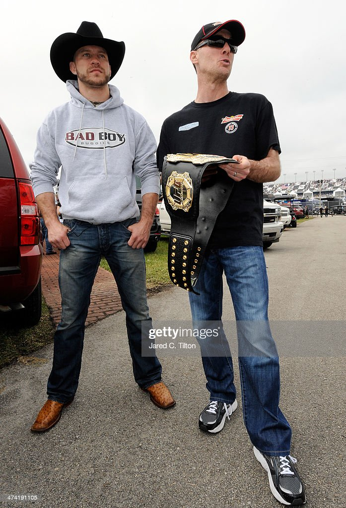 Donald 'Cowboy' Cerrone (L) presents NASCAR driver <a gi-track='captionPersonalityLinkClicked' href=/galleries/search?phrase=Kevin+Harvick&family=editorial&specificpeople=209186 ng-click='$event.stopPropagation()'>Kevin Harvick</a> with an UFC belt at Daytona International Speedway on February 22, 2014 in Daytona Beach, Florida.