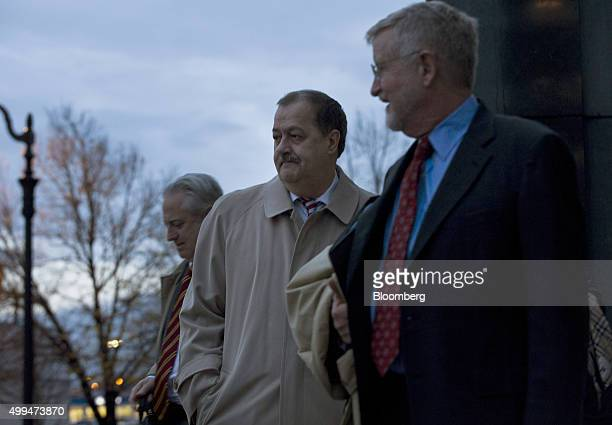 Donald 'Don' Blankenship former chief executive officer of Massey Energy Co center and his attorney Bill Taylor right leave the Robert C Byrd US...