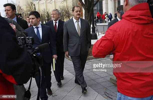 Donald 'Don' Blankenship former chief executive officer of Massey Energy Co center and attorneys Alex Macia left and Bill Taylor third from left exit...