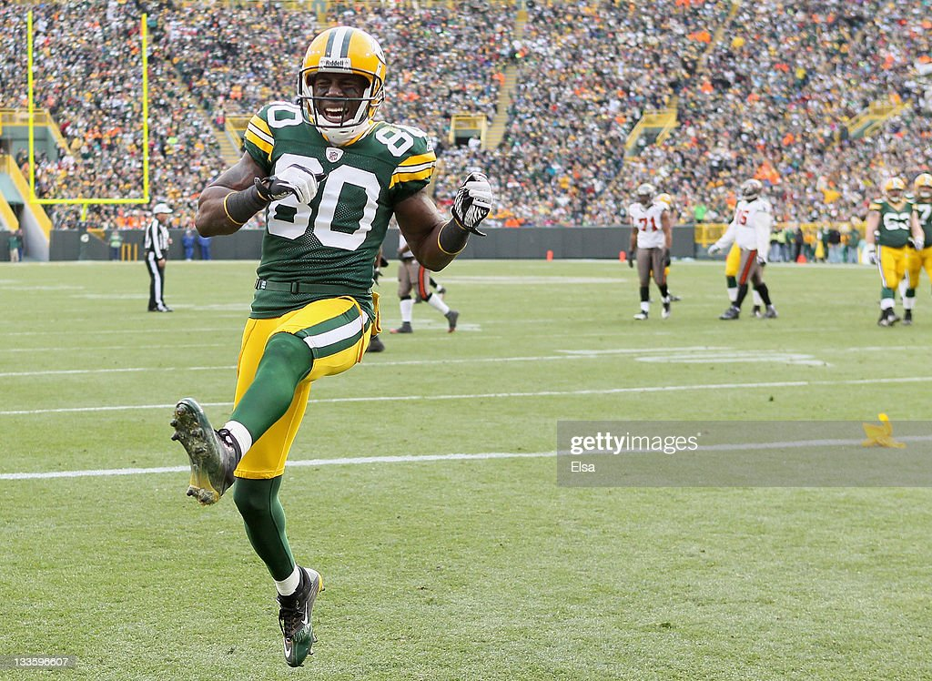 09babe5e8b9 ... Donald Driver 80 of the Green Bay Packers celebrates after E.J. Biggers  of the Tampa ...