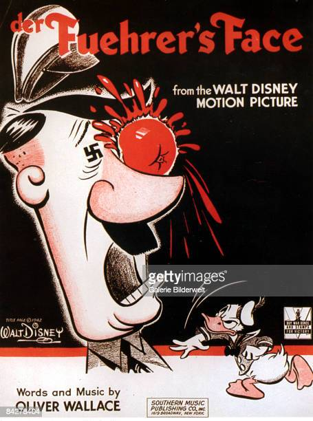 Donald Duck throws a tomato at Adolf Hitler on the sheet music for the title song of the Walt Disney film 'Der Fuehrer's Face' 1942
