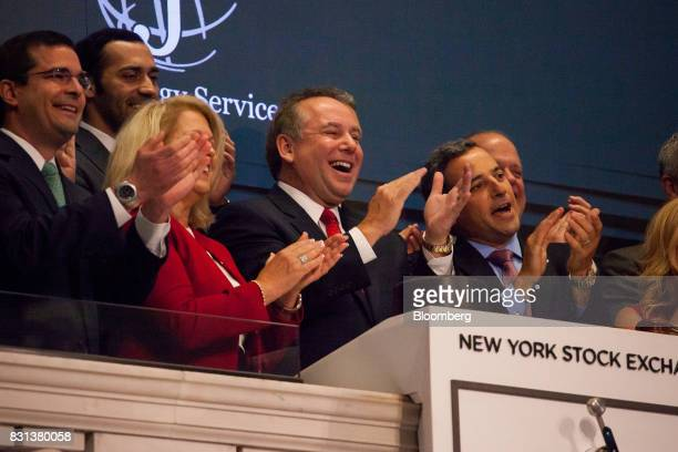 Donald Gawick president and chief executive officer of CJ Energy Services Inc center rings the opening bell on the floor of the New York Stock...