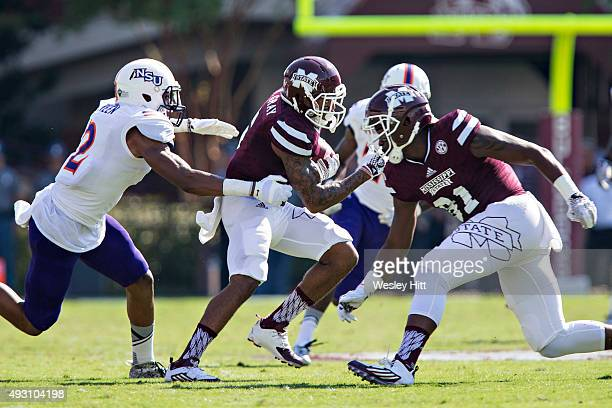 Donald Gray of the Mississippi State Bulldogs runs the ball and is caught from behind by Ralpheal Green of the Northwestern State Demons at Davis...