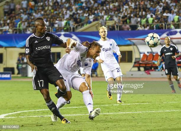 Donald Guerrier of Qarabag Agdam in action against Pierre Bengtsson of FC Copenhagen during the UEFA Champions League playoff match between Qarabag...