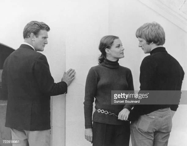 Donald Houston Romy Schneider and Dennis Waterman on the set of 'My Lover My Son' directed by John Newland London 1970