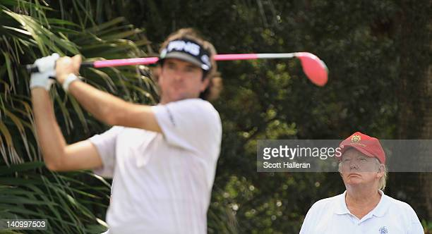 Donald J Trump watches as Bubba Watson hits his tee shot on the 12th hole during the second round of the World Golf ChampionshipsCadillac...