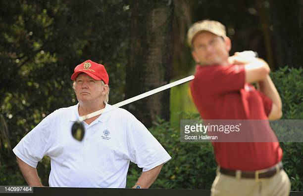 Donald J Trump watches as Mark Wilson hits his tee shot on the 12th hole during the second round of the World Golf ChampionshipsCadillac Championship...