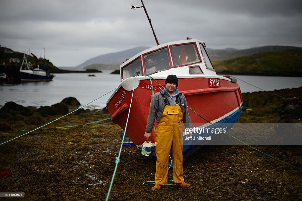 Donald John Macleod paints a fishing boat in Scalpay on May 15, 2014 in Harris, Scotland. The Isles of Lewis and Harris lie in the Outer Hebrides and make up the largest island in Scotland and stretch for 100 miles. The Isles of Harris and Lewis will vote along with the rest of Scotland in the referendum on whether Scotland should be an independent country on September 18, 2014. Harris and Lewis's economy is a mix of traditional businesses like fishing, weaving and farming, with more recent influence of tourism, the popularity of Harris and Lewis has grown steadily over recent years.