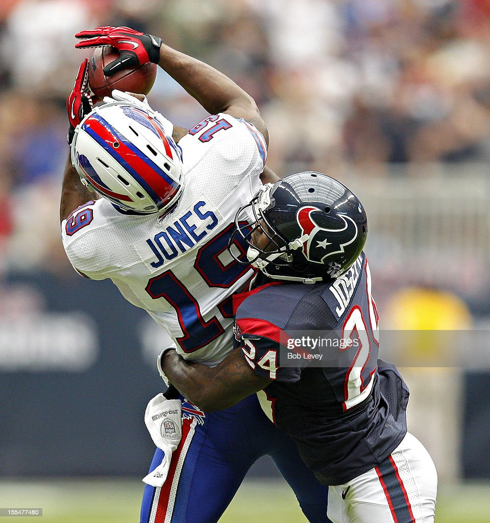 Donald Jones #19 of the Buffalo Bills goes up for a reception as Johnathan Joseph #24 of the Houston Texans makes the tackle at Reliant Stadium on November 4, 2012 in Houston, Texas. Houston defeated Buffalo 21-9.