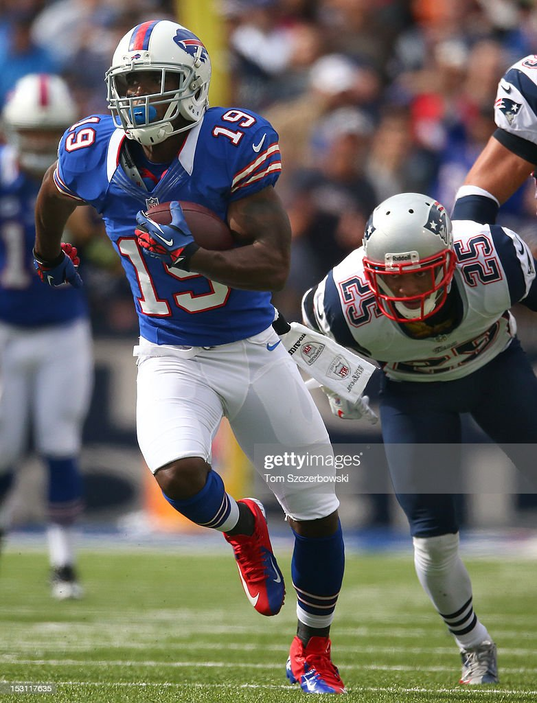 Donald Jones #19 of the Buffalo Bills runs for a touchdown during an NFL game as Patrick Chung #25 of the New England Patriots gives chase at Ralph Wilson Stadium on September 30, 2012 in Orchard Park, New York.