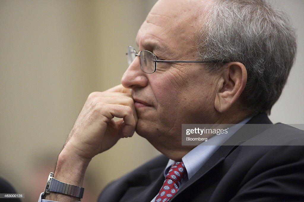 Donald Kohn, former vice chairman of the Board of Governors of the Federal Reserve System, listens as Ben S. Bernanke, chairman of the U.S. Federal Reserve, not pictured, speaks during a discussion at the Brookings Institution in Washington, D.C., U.S., on Thursday, Jan. 16, 2014. Bernanke defended quantitative easing, saying it has helped the economy while posing little risk of inflation. Photographer: Andrew Harrer/Bloomberg via Getty Images
