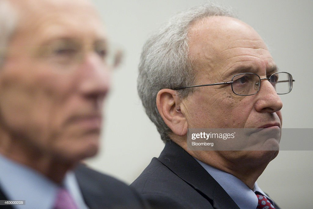 Donald Kohn, former vice chairman of the Board of Governors of the Federal Reserve System, right, and Stanley Fischer, former governor of the Bank of Israel and nominated to be vice chairman of the U.S. Federal Reserve, listen as Ben S. Bernanke, chairman of the U.S. Federal Reserve, not pictured, speaks during a discussion at the Brookings Institution in Washington, D.C., U.S., on Thursday, Jan. 16, 2014. Bernanke defended quantitative easing, saying it has helped the economy while posing little risk of inflation. Photographer: Andrew Harrer/Bloomberg via Getty Images