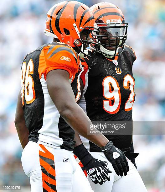 Donald Lee and Frostee Rucker of the Cincinnati Bengals against the Jacksonville Jaguars at EverBank Field on October 9 2011 in Jacksonville Florida...