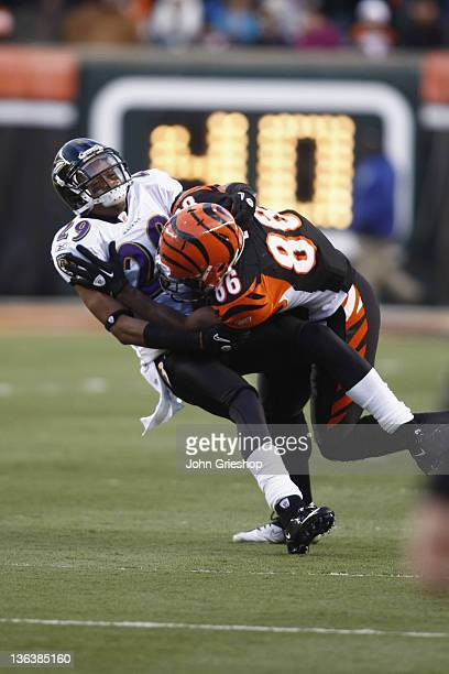 Donald Lee of the Cincinnati Bengals is tackled by Cary Williams of the Baltimore Ravens during their game at Paul Brown Stadium on January 1 2012 in...