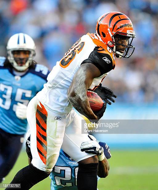 Donald Lee of the Cincinnati Bengals makes a catch against Jordan Babineaux of the Tennessee Titans during play at LP Field on November 6 2011 in...