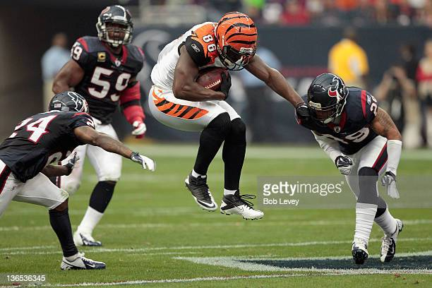 Donald Lee of the Cincinnati Bengals makes a reception in the first half against Glover Quin of the Houston Texans during their 2012 AFC Wild Card...