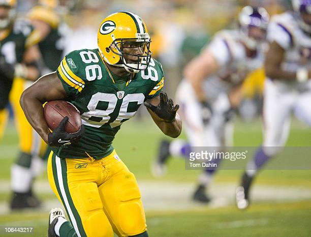 Donald Lee of the Green Bay Packers carries the ball during a NFL game against the Minnesota Vikings at Lambeau Field on October 23 2010 in Green Bay...