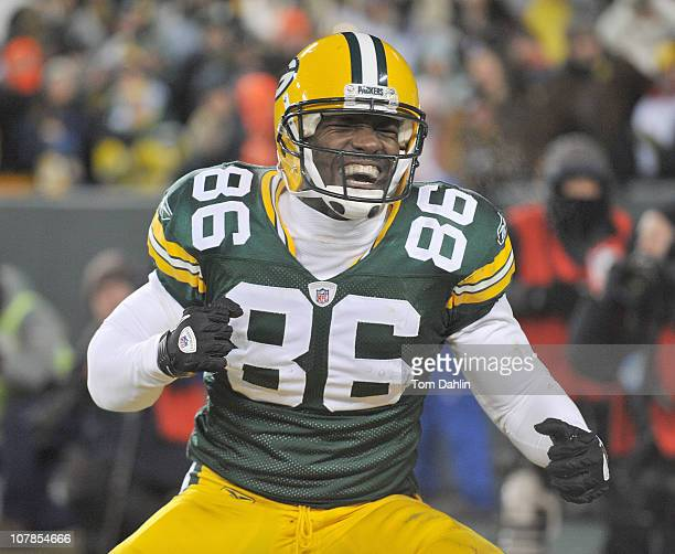 Donald Lee of the Green Bay Packers celebrates a touchdown during an NFL game against the Chicago Bears at Lambeau Field on January 2 2011 in Green...
