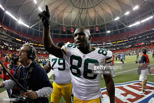 Donald Lee of the Green Bay Packers celebrates as he walks off the field after the Packers won 4821 against the Atlanta Falcons during their 2011 NFC...