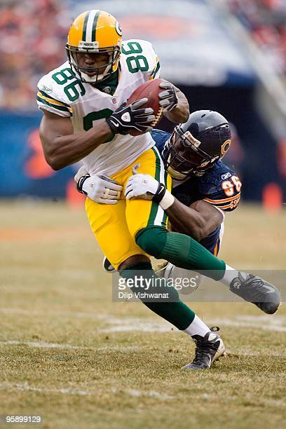 Donald Lee of the Green Bay Packers runs up field against the Chicago Bears at Soldier Field on December 13 2009 in Chicago Illinois