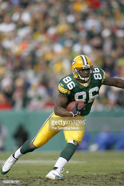 Donald Lee of the Green Bay Packers runs with the ball during a game against the Detroit Lions on December 17 2006 at Lambeau Field in Green Bay...