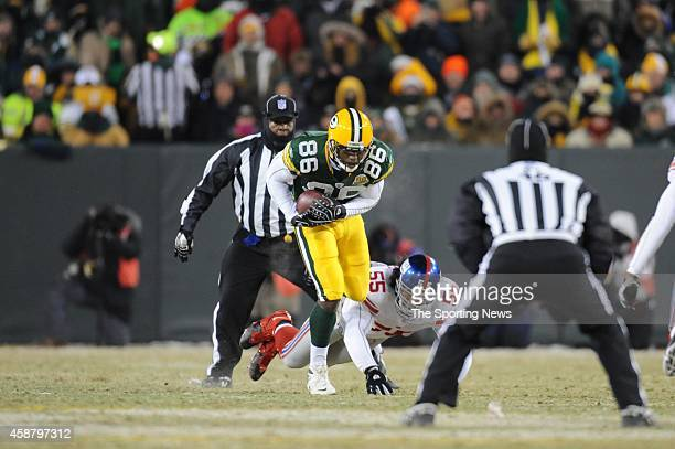 Donald Lee of the Green Bay Packers runs with the ball during a game against the New York Giants on January 20 2008 at Lambeau Field in Green Bay...