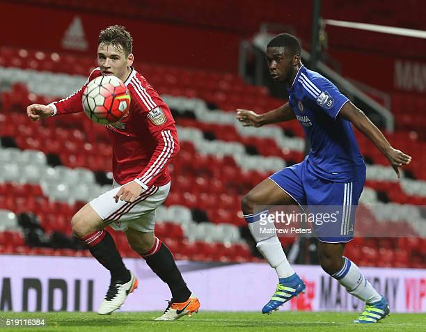 Donald Love of Manchester United U21s in action with Fikayo Tomori of Chelsea U21s during the U21 Premier League match between Manchester United U21s...