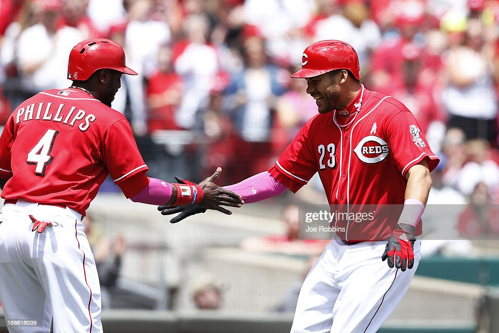 Donald Lutz #23 of the Cincinnati Reds celebrates with teammate Brandon Phillips #4 after hitting a three-run homer in the second inning against the Milwaukee Brewers during the game at Great American Ball Park on May 12, 2013 in Cincinnati, Ohio.