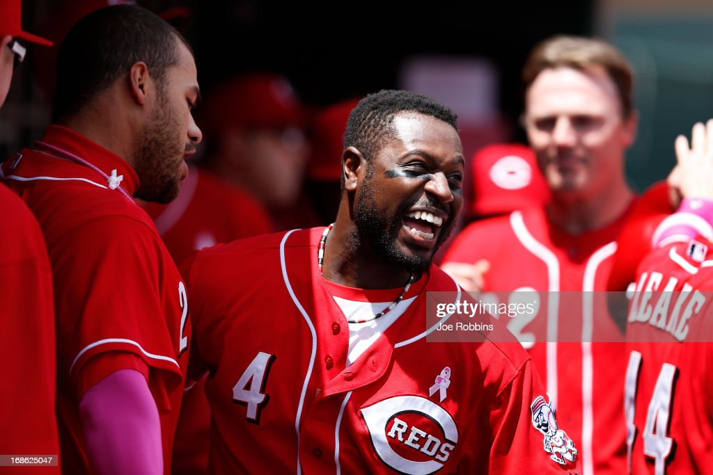 Donald Lutz #23 of the Cincinnati Reds celebrates with teammate Brandon Phillips #4 after hitting a three-run homer in the second inning against the Milwaukee Brewers during the game at Great American Ball Park on May 12, 2013 in Cincinnati, Ohio. The Reds won 5-1.
