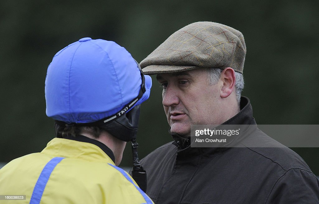 Donald McCain chats with <a gi-track='captionPersonalityLinkClicked' href=/galleries/search?phrase=Jason+Maguire&family=editorial&specificpeople=167161 ng-click='$event.stopPropagation()'>Jason Maguire</a> at Kempton racecourse on January 25, 2013 in Sunbury, England.