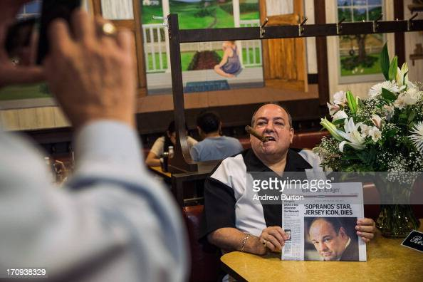 Donald Metzger a James Gandolfini and Tony Soprano impersonator poses for photos at the booth where the final scene of the final episode of the HBO...
