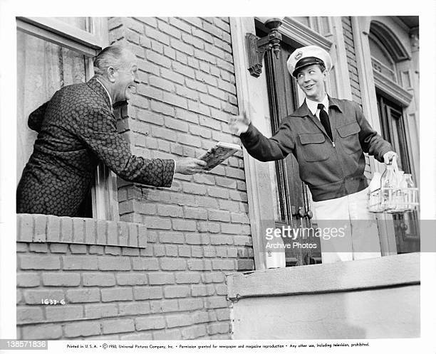 Donald O'Connor gives GradeA service to a customer in a scene from the film 'Milkman' 1950