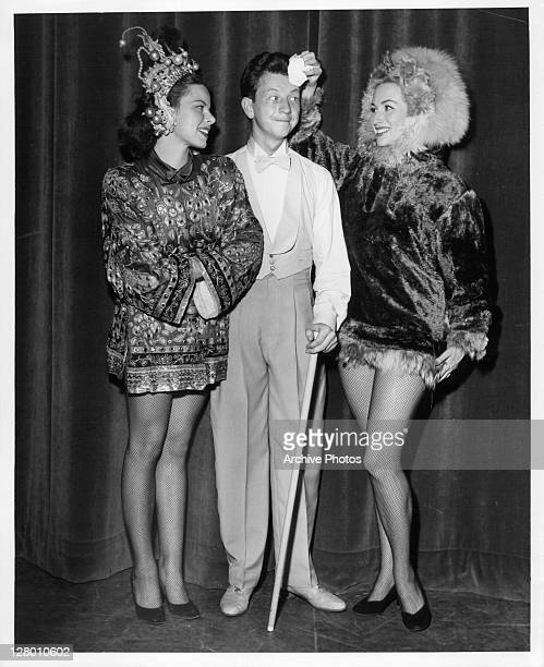 Donald O'Connor in the middle of Betty Scott and Jan Hollar in a scene from the film 'Colgate Comedy Hour' 1955