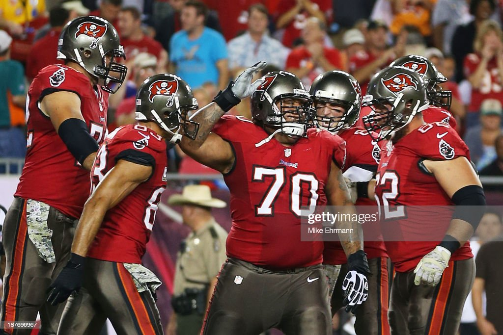 <a gi-track='captionPersonalityLinkClicked' href=/galleries/search?phrase=Donald+Penn&family=editorial&specificpeople=749132 ng-click='$event.stopPropagation()'>Donald Penn</a> #70 of the Tampa Bay Buccaneers celebtrates his first quarter touchdown against the Miami Dolphins teammates at Raymond James Stadium on November 11, 2013 in Tampa, Florida.