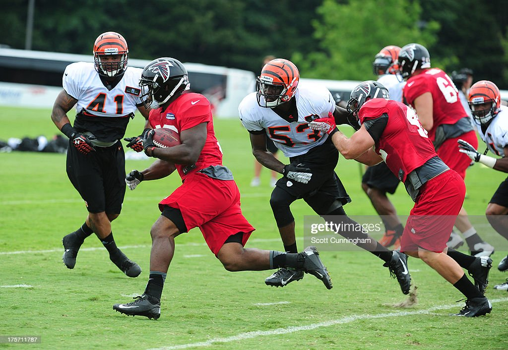 Donald Russell #33 of the Atlanta Falcons carries the ball during practice against the Cincinnati Bengals at the Atlanta Falcons Training Complex on August 6 2013 in Flowery Branch, Georgia.