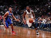 Donald Sloan of the Brooklyn Nets handles the ball against Ish Smith of the Philadelphia 76ers on March 15 2016 at Barclays Center in Brooklyn New...