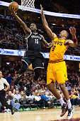 Donald Sloan of the Brooklyn Nets shoots over Channing Frye of the Cleveland Cavaliers during the second half at Quicken Loans Arena on March 31 2016...