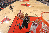 Donald Sloan of the Brooklyn Nets shoots the ball against Derrick Rose of the Chicago Bulls on December 21 2015 at the United Center in Chicago...