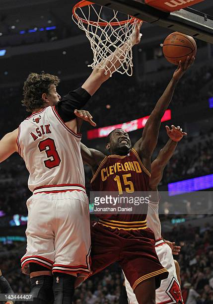 Donald Sloan of the Cleveland Cavaliers drives between Omer Asik and Ronnie Brewer of the Chicago Bulls at the United Center on April 26 2012 in...