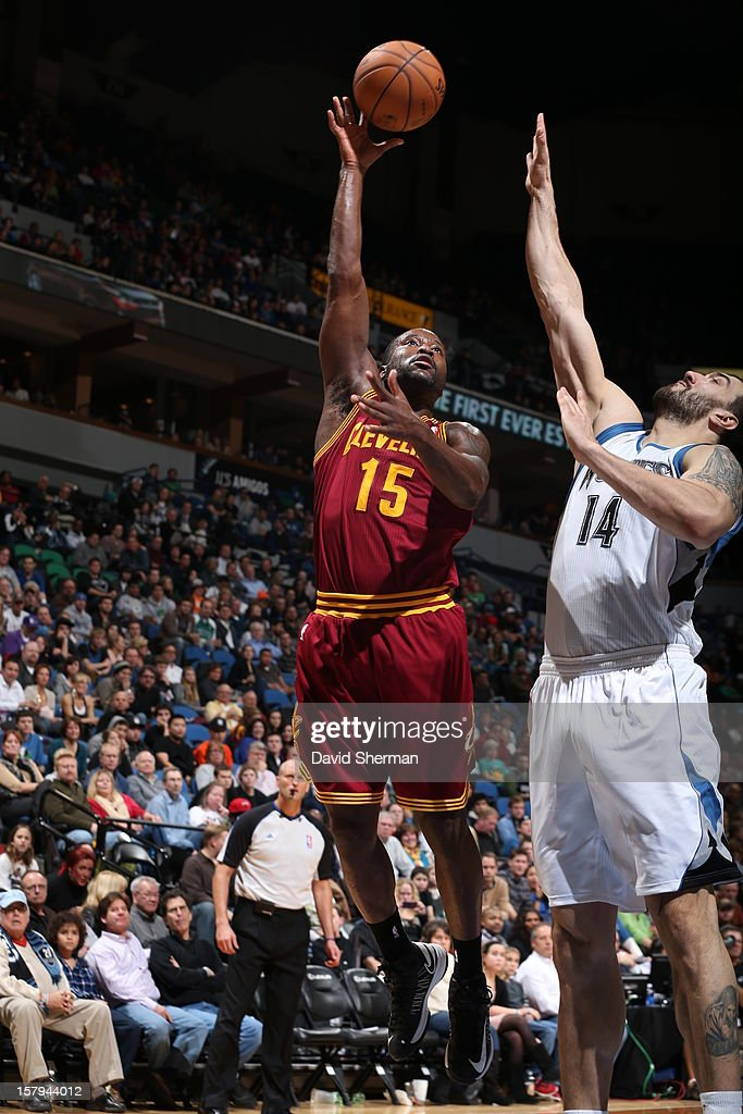 Donald Sloan #15 of the Cleveland Cavaliers goes up for a shot against Nikola Pekovic #14 of the Minnesota Timberwolves during the game on December 7, 2012 at Target Center in Minneapolis, Minnesota.