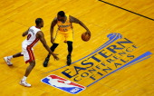 Donald Sloan of the Indiana Pacers brings the ball up the floor as Toney Douglas of the Miami Heat defends during Game Six of the Eastern Conference...