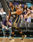 Donald Sloan of the Indiana Pacers dribbles the ball up court against the Charlotte Hornets during the game at the Time Warner Cable Arena on October...