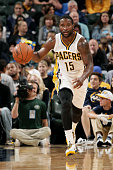 Donald Sloan of the Indiana Pacers drives against the Dallas Mavericks at Bankers Life Fieldhouse on October 18 2014 in Indianapolis Indiana NOTE TO...
